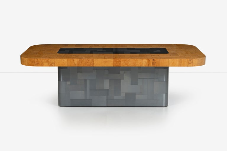 Paul Evans olive ash burl wood and steel cityscape dining table, this table has a racetrack top, outer edge Burl Wood inside serving surface metal cladded tiles like base. Dimensions: 96