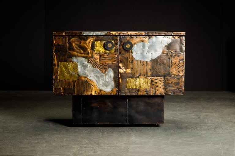 Stunning copper clad cabinet by Paul Evans for Directional, produced in circa 1967. This incredible piece of design history is fabricated from patinated pieces of copper, brass, and pewter which have been welded and nailed in a patchwork style