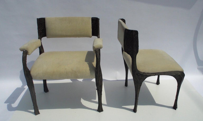 A set of 6 Paul Evans dining chairs. 2 armchairs and 4 side chairs Original surface and upholstery. Bronzed resin over steel.