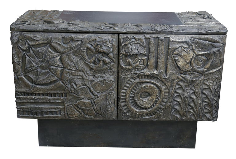 Paul Evans sculpted bronze cabinet Incised signature and date Original surface, grain painted interior and shelf.