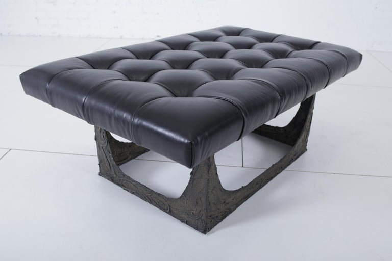 "Sculpted bronze bench by Paul Evans. New black leather upholstery. Signed ""PE 69""."