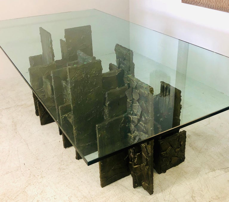 A Paul Evans dining table in the sculpted bronze technic. Multiple rectangular elements are arranged in a skyline manner. The rectilinear angular design is complemented by rich abstract bronze textures. Retains the 96
