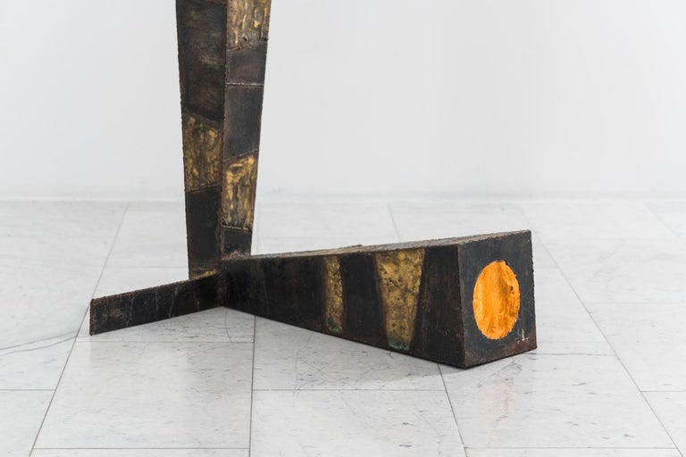 A fantastic example of an early, commissioned sculptural steel lamp by Paul Evans, the L-shaped lamp's square obelisk body is formed from rectilinear sections of welded steel with alternating blackened and polychromed enamel in a patchwork