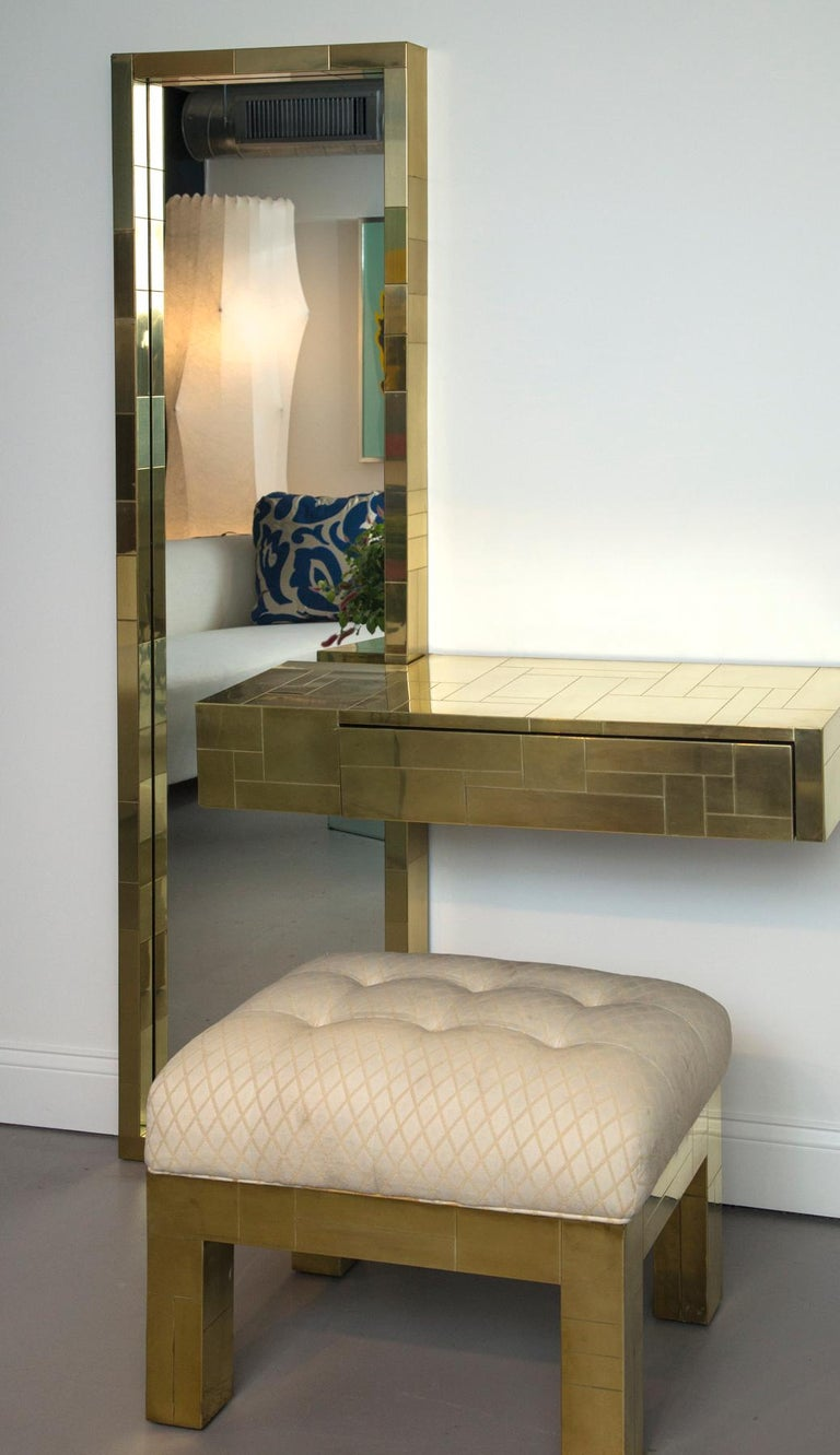 Paul Evans signed cityscape brass console with mirror and upholstered bench Measures: Bench 17