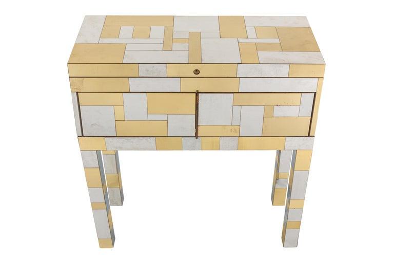 Chest features hinged top concealing twenty one finish sample cubes offered in the Cityscape Collection. and two doors concealing open storage containing a sample hinge and additional samples of veneer. Etched signature to reverse