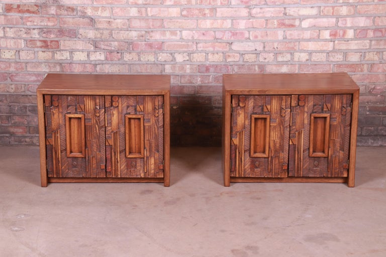An exceptional pair of Mid-Century Modern Brutalist oak nightstands or side tables  In the manner of Paul Evans  By Lane Furniture
