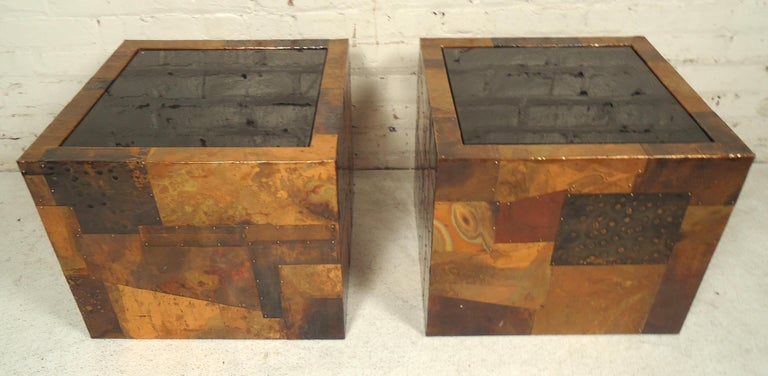 Striking mixed metal side tables with black tinted glass tops. Hammered metal sheets in a patchwork Brutalist style.