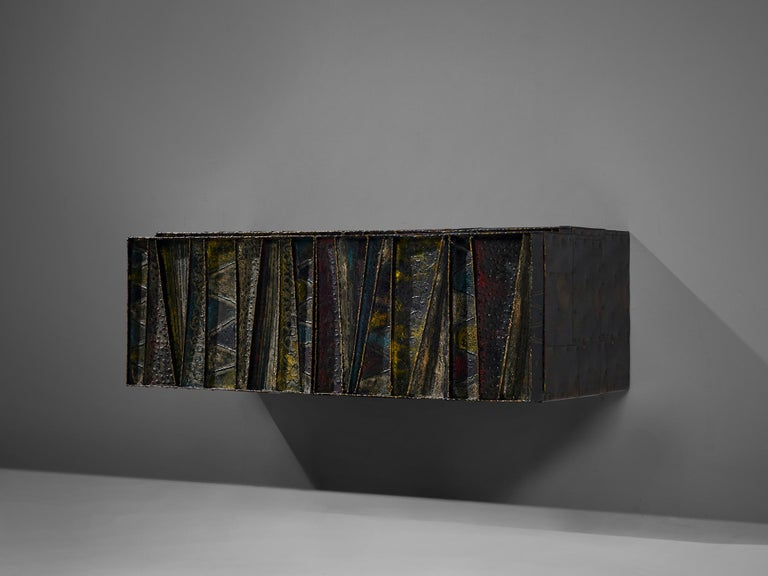 Paul Evans for Paul Evans Studio, deep relief, wall-mounted sideboard model PE-19, welded and patinated steel, slate and darkened wood, United States, circa 1972  Paul Evans 'Deep Relief' wall-mounted cabinet with welded and patinated steel doors