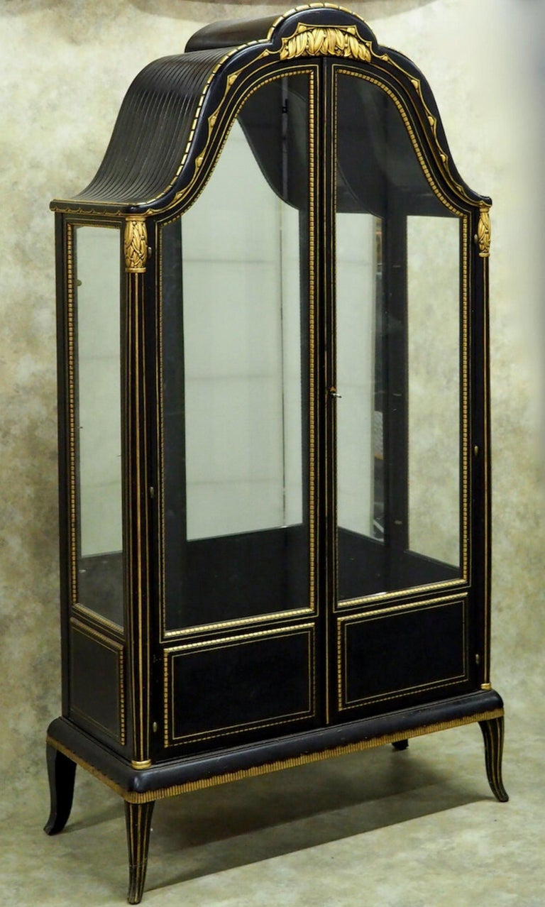 """Early Classic Art Deco display cabinet/vitrine by Paul Follot, circa 1918, in original blue/black lacquer and with original gilding. This exquisite cabinet is a masterpiece of sculpting and detail in exceptional original condition. 40"""" wide x 18"""""""