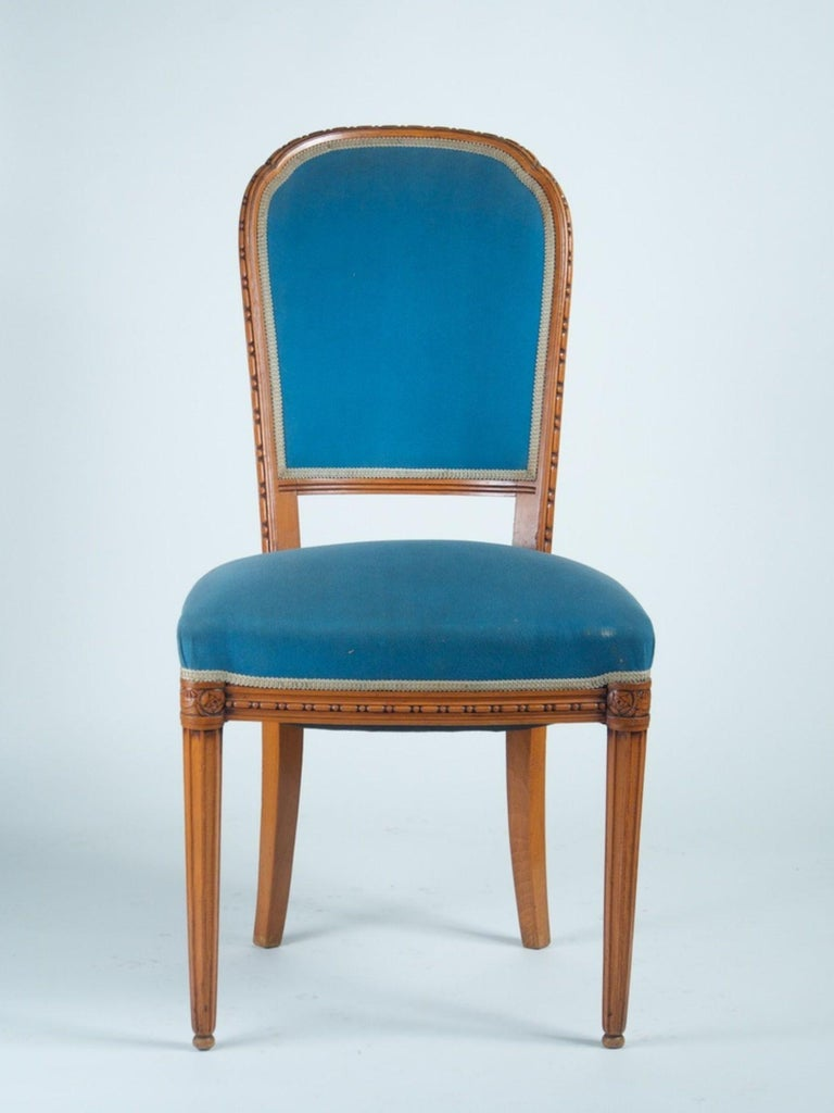 Early Classic French Art Deco pair of side chairs in sculpted cherry, circa 1920. Measures: 19