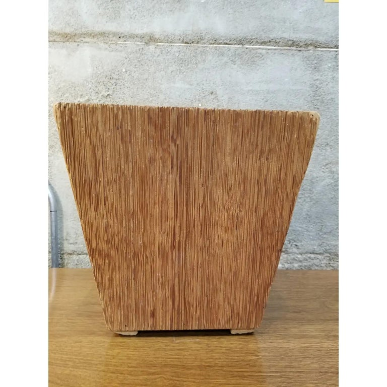 A Mid-Century Modern waste basket attributed to Paul Frankl. Made of combed fir with a conical four sided rectangular design. This item was acquired from a private estate in California, the entire home was filled with Paul Frankl furniture.