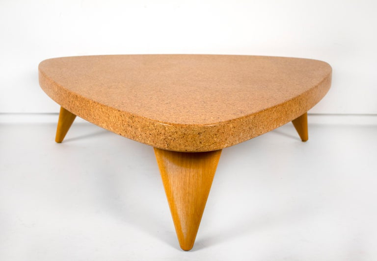 Seldom seen in the raw cork with the bleached mahogany legs. This model #5030 table was produced in 1951 by the Johnson Furniture Company. The shape of the legs and the unique form of the top in tandem with the texture of the cork and tone of the