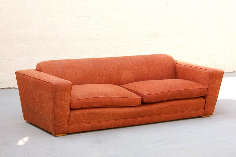 Rare Art Deco club / speed sofa by acclaimed Art Deco designer Paul Frankl. Iconic streamline design. Structurally in very good condition. Original orange tweed upholstery shows wear as pictured. Sold as is. 