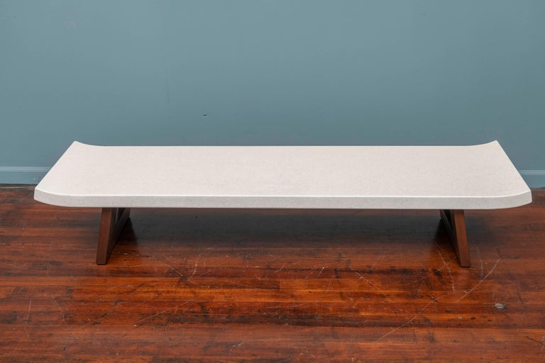 Paul Frankl design for Johnson Furniture co. cork top low table or bench, Model 5004. Influenced by Japanese architecture and made with a pierced mahogany base and a cork veneered top. Perfectly refinished and ready to install.