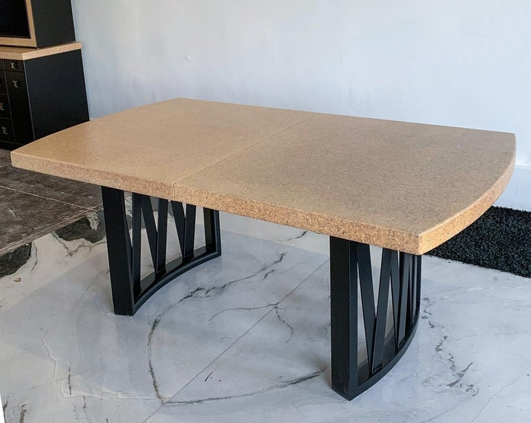 This dining table is absolutely stunning! Professionally restored, this Paul Frankl for Johnson Furniture, distributed by John Stuart cork top dining table with ebonized (black satin) frame.   This dining table features its original cork top in a