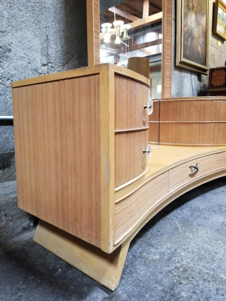 Amazing and dramatic design in this drop-well dressing vanity designed by Paul Frankl for Brown-Saltman, Llte 1940s-early 1950s. Combed fir detail with original Lucite pulls. Five drawers for lots of storage. Tall, full length mirror for ample