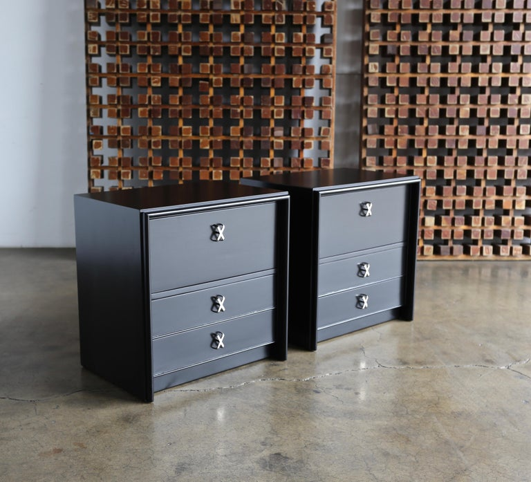 Paul Frankl ebonized nightstands for Johnson Furniture Company, circa 1950. This pair has been professionally restored. Freshly nickel-plated hardware.