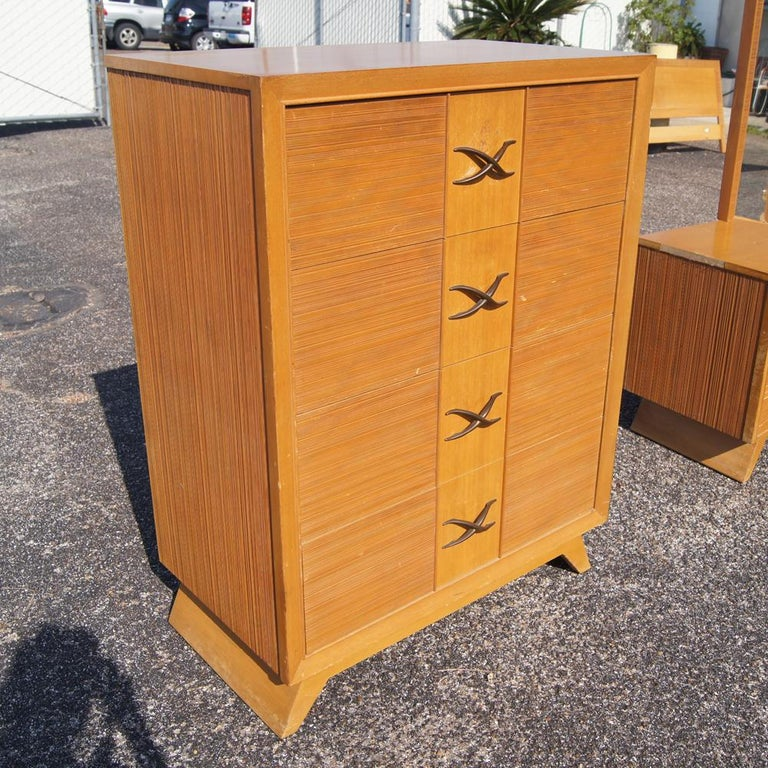 A mid century modern chest of drawers designed by Paul Frankl and made by Brown Saltman.  An oak case with combed oak drawer fronts and signature Frankl X pulls.  As shown in the last image, we have several matching pieces of Paul Frankl bedroom