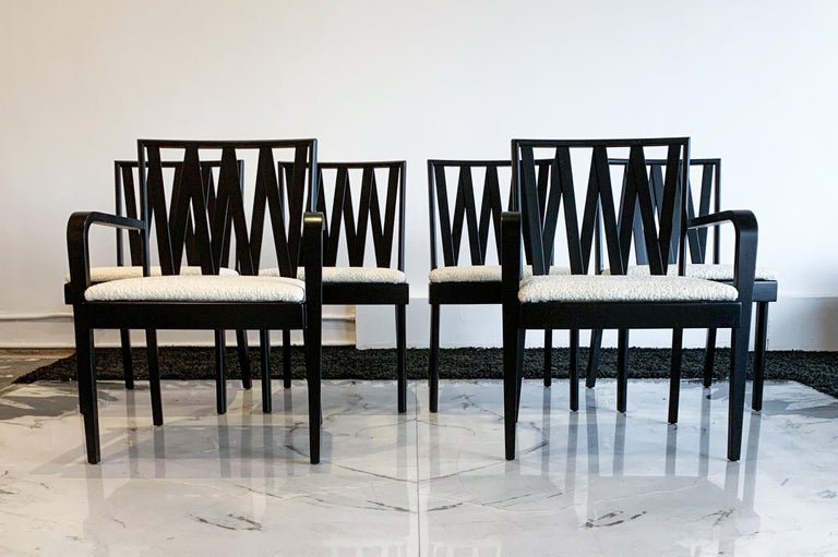 These dining chairs are absolutely stunning! Professionally restored, these chairs were designed by Paul Frankl for Johnson Furniture, distributed by John Stuart and feature an ebonized (black satin) frame and are upholstered in a sumptuous white