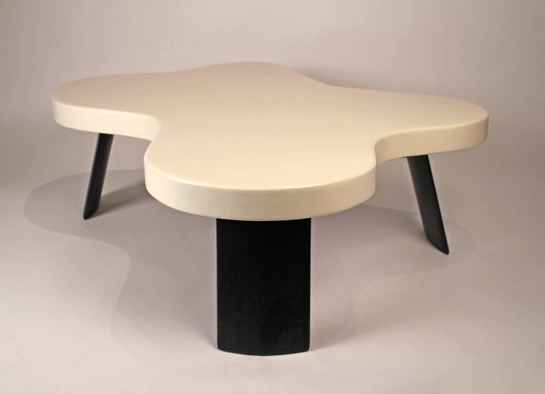 One of Frankl's most successful and iconic table designs. The Amoeba cocktail table is comprised of a lacquered cork top with stained mahogany legs and was produced by the Johnson Furniture company in the 1950s. Signed to underside with stencilled