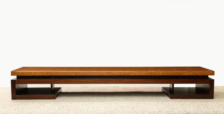 Asian-inspired form with cork-wrapped top above dark-stained mahogany base. This piece is designed by Paul Frankl for Johnson furniture company from the post war period.