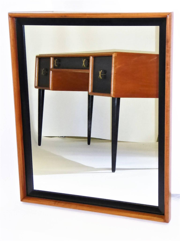 Beautiful Mid-Century Modern creation by master Paul Frankl, a Streamline Moderne mirror, the frame of blond cherry and black lacquer. Made by Johnson Furniture, it was retailed by John Stuart Inc. (See pics). Deftly restored. Wire can be changed to