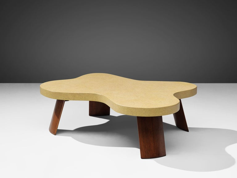 Paul Frankl for Johnson Furniture, coffee table 'No 5005', lacquered cork, mahogany, USA, 1950s.  This biomorphic shaped coffee table designed by Paul Frankl has a cork laminated tabletop. The bright tone of the cloud-like designed shape forms a