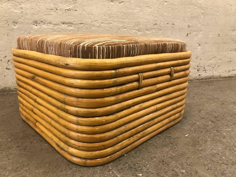 Paul Frankl bent rattan ottoman. Newly upholstered loose cushion.
