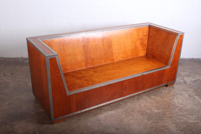 A rare sofa designed by Paul Frankl and exhibited at the 1933-1934 Chicago World's Fair. Walnut sofa with nickeled brass mounts.     A pair of chairs from the same exhibition sold at Christies, December 7-2005, lot 86.