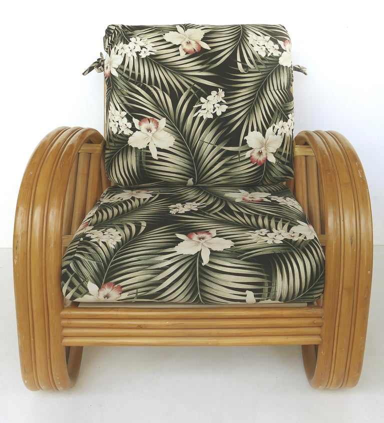 Paul Frankl style rattan pretzel club chair and ottoman with three bands  Offered for sale is a Mid-Century Modern pretzel club chair and ottoman in the manner of Paul Frankl. The set is from King's Rattan of California and is nicely upholstered