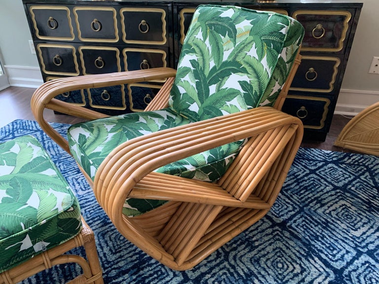 Vintage rattan lounge chair and ottoman in the manner of Paul Frankl features coveted six strand design and new palm leaf upholstery. Matching ottoman included. Very good condition with very minor imperfections consistent with gentle use. New