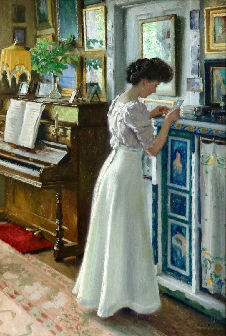Oil on panel by Danish painter Paul Gustave Fischer depicting an elegant young woman, Harriet, in an interior reading a letter. There is a piano in the corner of the room and framed pictures adorn the walls. Harriet was the artists daughter and he
