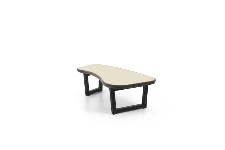 Laszlo for brown and Saltman Amoeba coffee table, Cerused mahogany frame withhold scalloped legs, replaced leather top. Tabletop depth 25