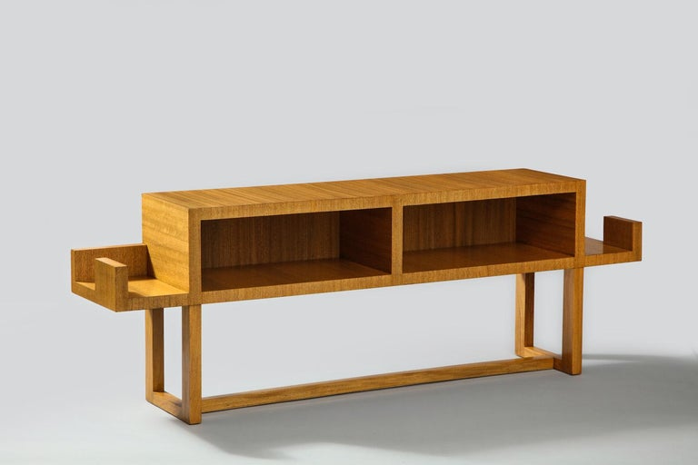Custom-designed console table by Paul Laszlo. Architectural form, bleached mahogany table with open storage. An early and highly desirable Laszlo design. Published: Paul Laszlo, Interiors/ Exteriors, 1937-1947, Pg. 37. Provenance: Estate of George