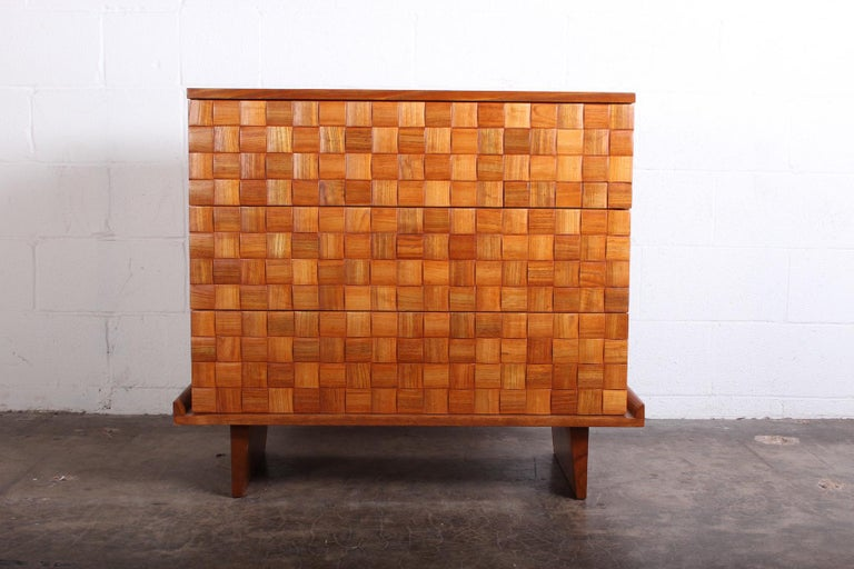 An oak three-drawer chest designed by Paul Laszlo for Brown Saltman.