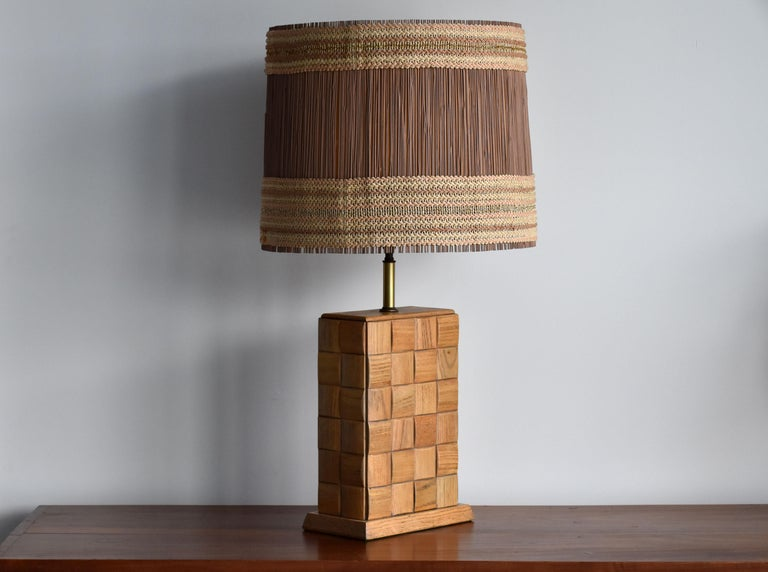A large modernist table lamp by Paul Laszlo, fitted with a Maria Kipp shade, most likely secondary to lamp. Produced by Brown Saltman.   The base features Laszlo's iconic chess pattern that was incorporated in his designs for Brown Saltman.   Other