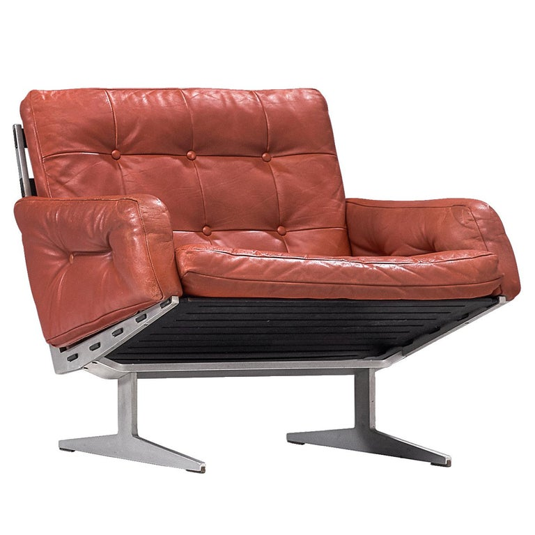 Paul Leidersdorff for Cado, 'Caravelle' lounge chair, leather, aluminum and wood, Denmark, 1960s  Modern armchair created by Paul Leidersdorff for Cado. The slipper chair holds a L-shaped seating, moreover, this shape is repeated in the legs. A