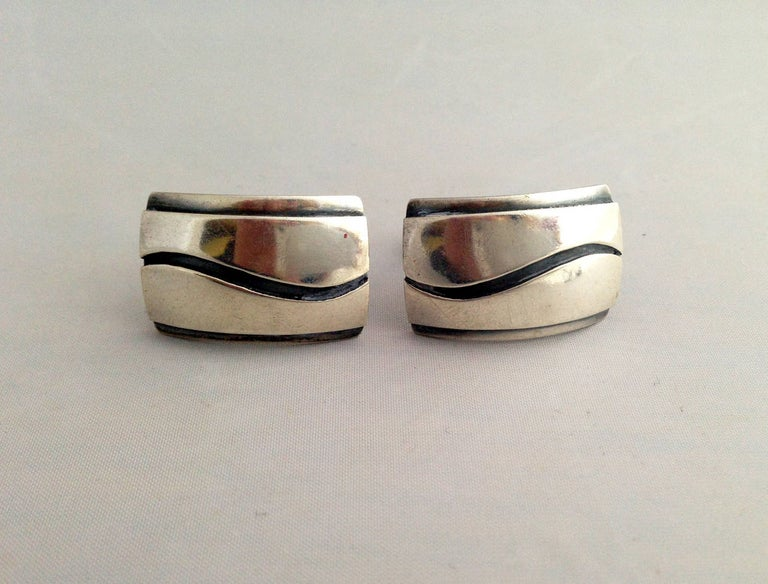 Large scale sterling silver cufflinks with applied wave design created by Paul Lobel of New York, circa 1950's.  Cufflinks measure 1 1/8