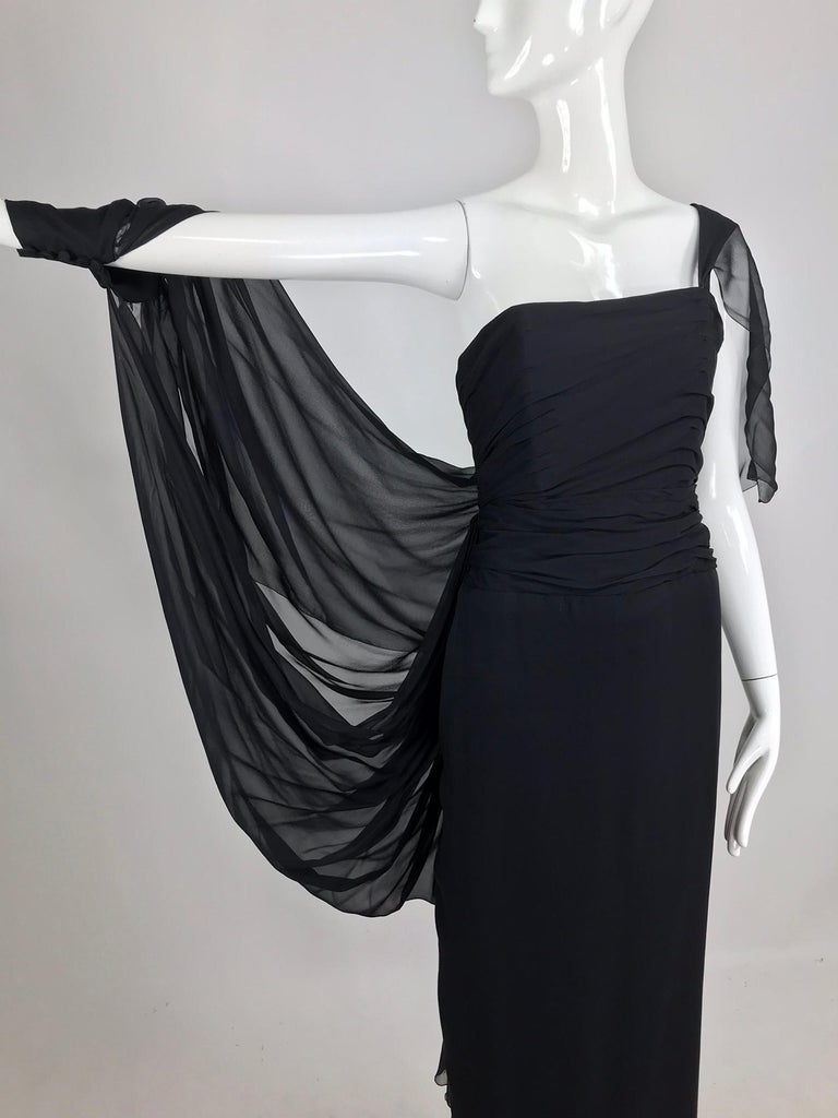 Paul-Louis Orrier black silk chiffon one sleeve demi couture gown from the early 1980s.  Orrier may be better known for his 80s poof and glitter confections, but this dress done in silk chiffon shows command of a notoriously difficult to work with
