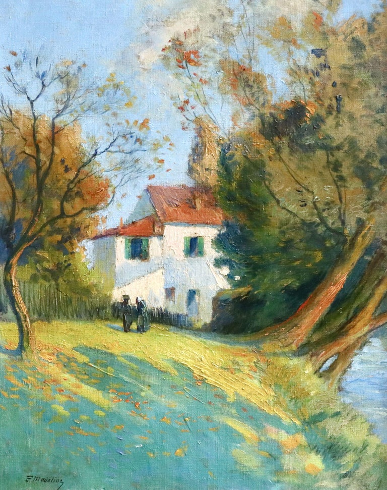 Oil on canvas circa 1910 by Paul Madeline depicting a serene scene of two figures standing in front of a cottage overlooking a river on a sunny day. Signed lower left. Framed dimensions are 23 inches high by 20 inches wide.  Paul Madeline was a