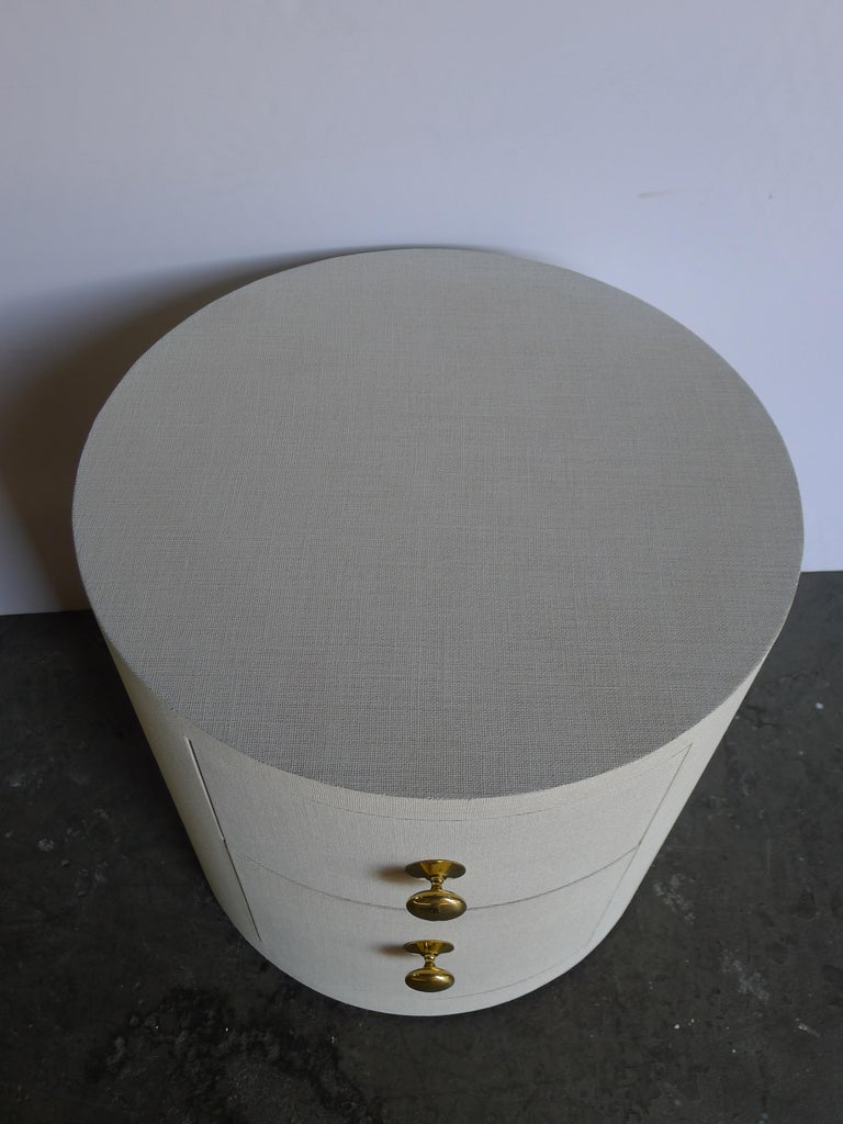 Linen-wrapped Paul Marra Italian inspired round nightstands. Shown 26