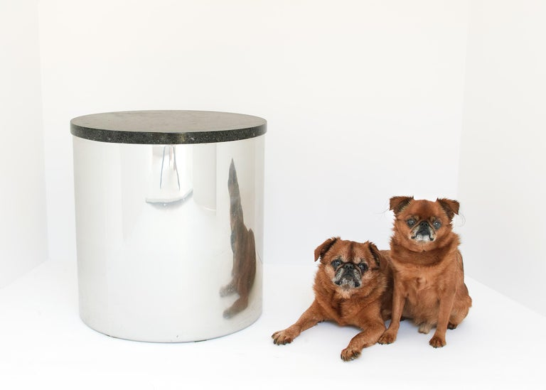 Steel base with mirror finish and matte black interior. Granite top conceals storage within. Original labels on bottom.