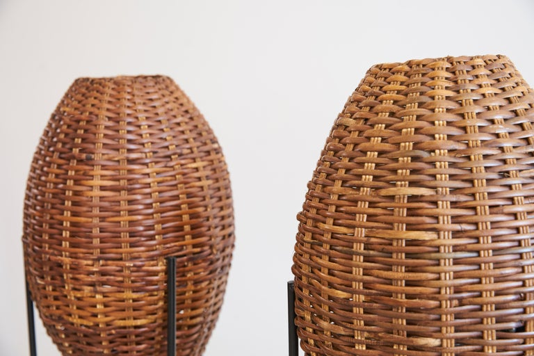 Pair of woven rattan lights attributed to Paul Mayen with iron hairpin leg. Newly rewired.