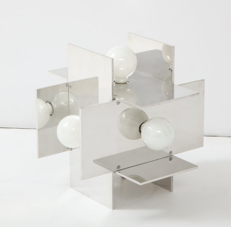 Constructivist table lamp in polished, reflective aluminum designed by Paul Mayen for Habitat, circa 1968. Catalog #9098. The Spanish-born and Cooper-Union and Columbia University educated Mayen founded Habitat in the early 1950's; Habitat would