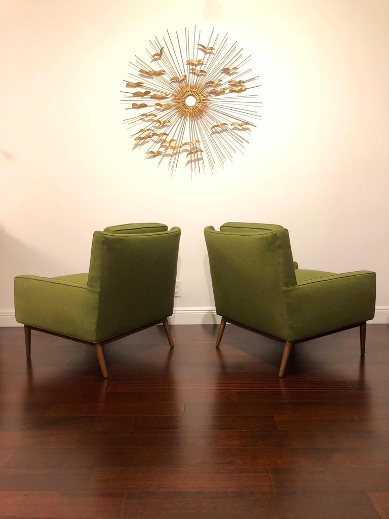 Gorgeous pair of lounge chairs attributed to Paul McCobb. Freshly refinished frames/ legs, new foam, and new upholstery. Ready for another lifetime of use.