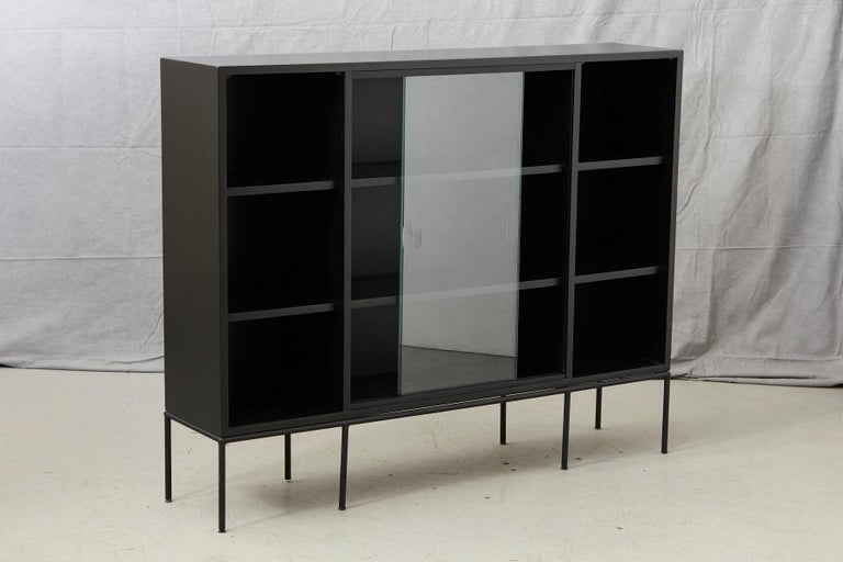 Mid-Century Modern Paul McCobb Bookcase in New Black Finish with Sliding Glass Doors on Iron Base For Sale