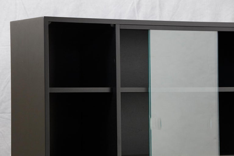 Paul McCobb Bookcase in New Black Finish with Sliding Glass Doors on Iron Base In Good Condition For Sale In Weston, CT