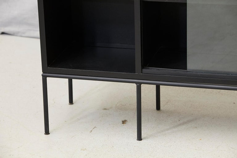 20th Century Paul McCobb Bookcase in New Black Finish with Sliding Glass Doors on Iron Base For Sale