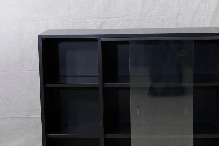 Steel Paul McCobb Bookcase in New Black Finish with Sliding Glass Doors on Iron Base For Sale