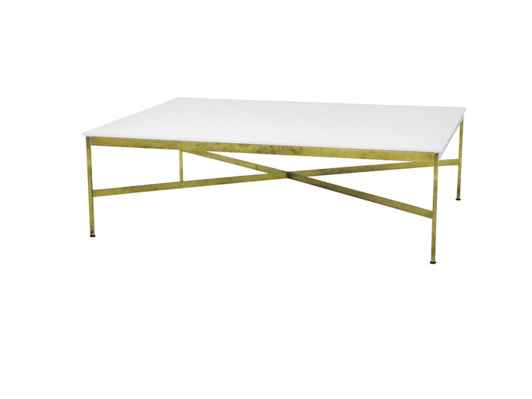 Brass frame coffee table with white Vitrolite glass. Designed by Paul McCobb for Calvin Furniture.